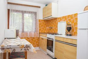 Küche/Küchenzeile in der Unterkunft Familia nyaraló 16